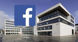 Gießener Rathaus mit Facebook-Button im Vordergrund