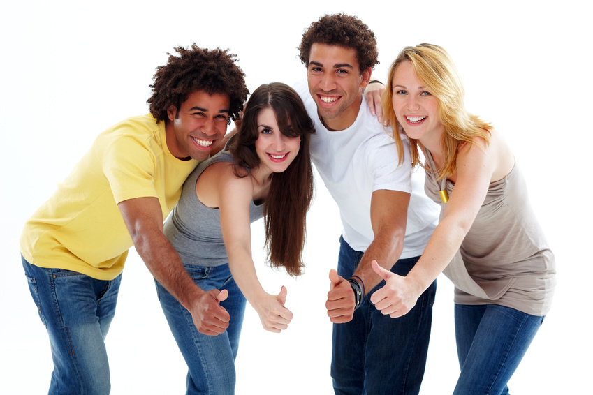 a group of two black boys and two caucasian girls with thumbs up
