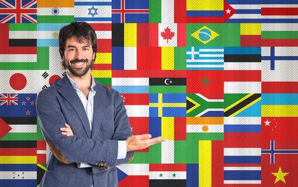 Businessman presenting something over flags background